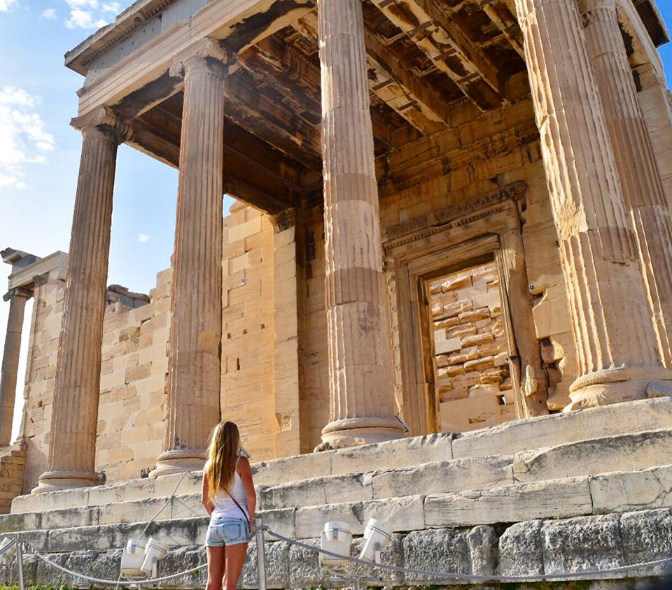 Girl standing in front of ruins in Athens Greece