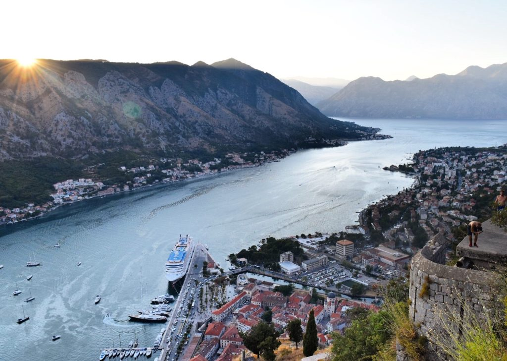 Looking at mountains, lake and old town of Kotor from the Kotor Fortress at Sunset bucket list destinations