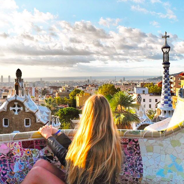 Girl looking out over the view of Park Guell