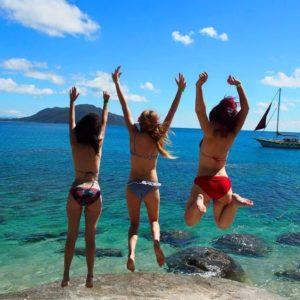 3 Girls jumping at Fitzroy Island near Cairns