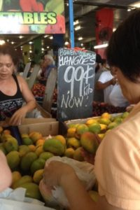 Rusty market lady selling mangos