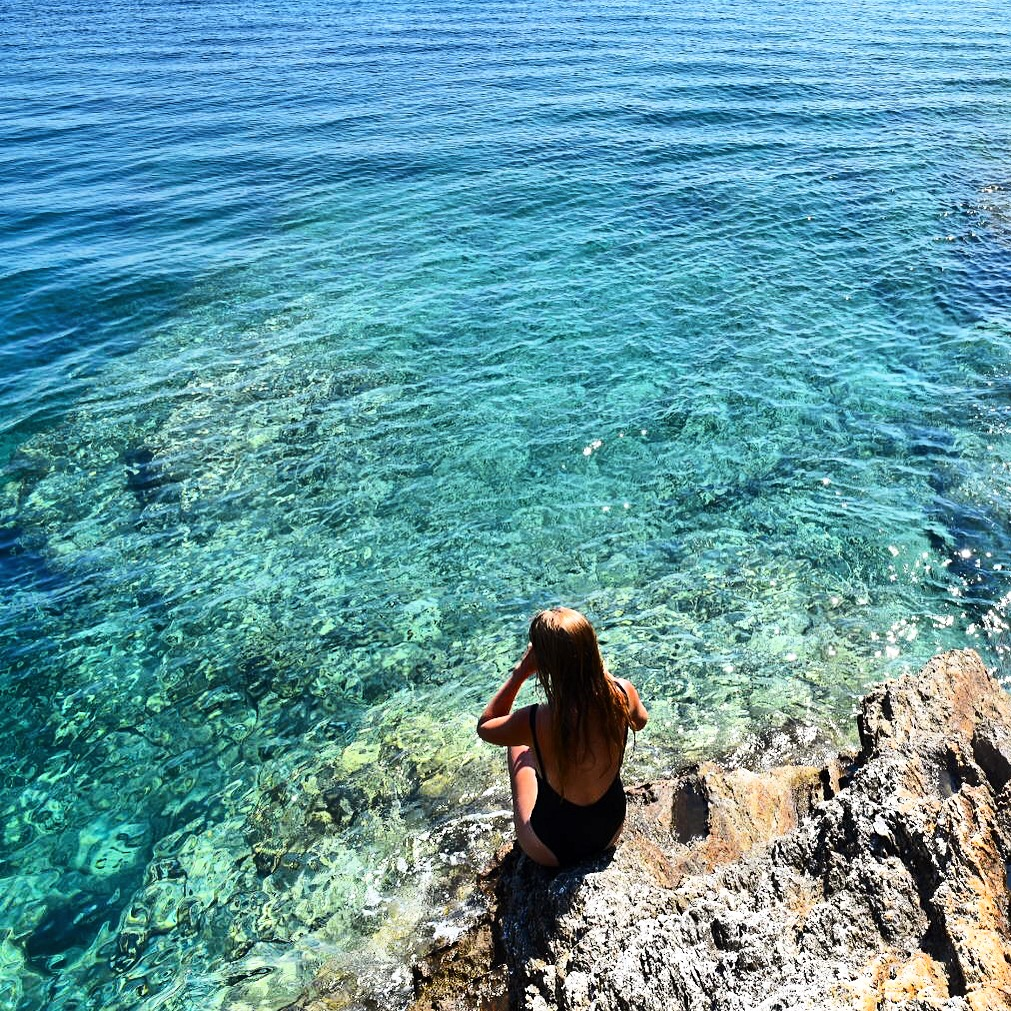 girl next to ocean in Ios, Greece
