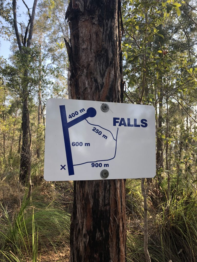 Sign direction to Windin Falls attached to a tree