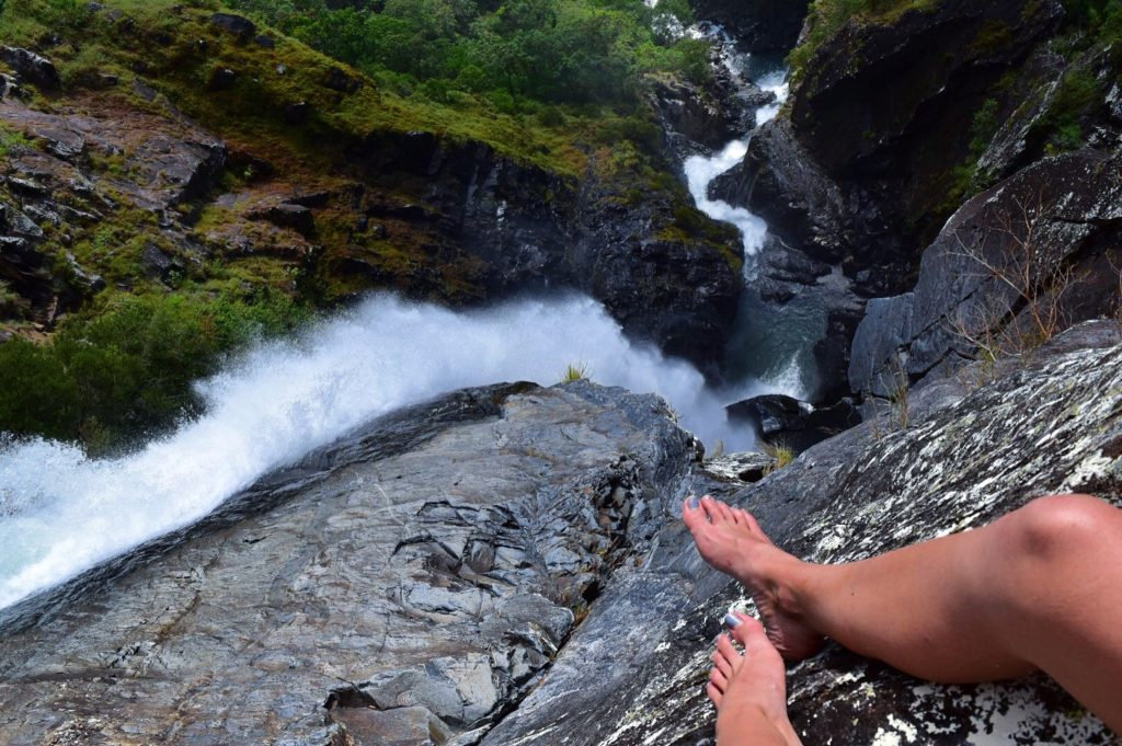 Feet hanging over the side of Windin Falls