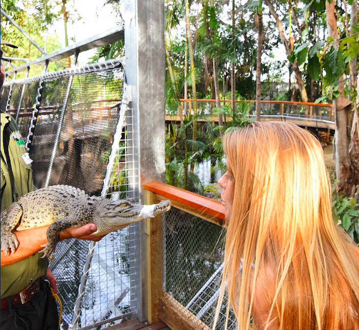 Girl kissing crocodile