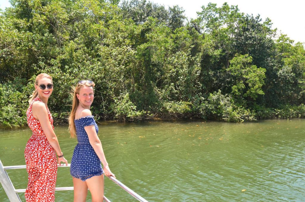 Two girls standing at the front of a boat at Daintree River Cruise