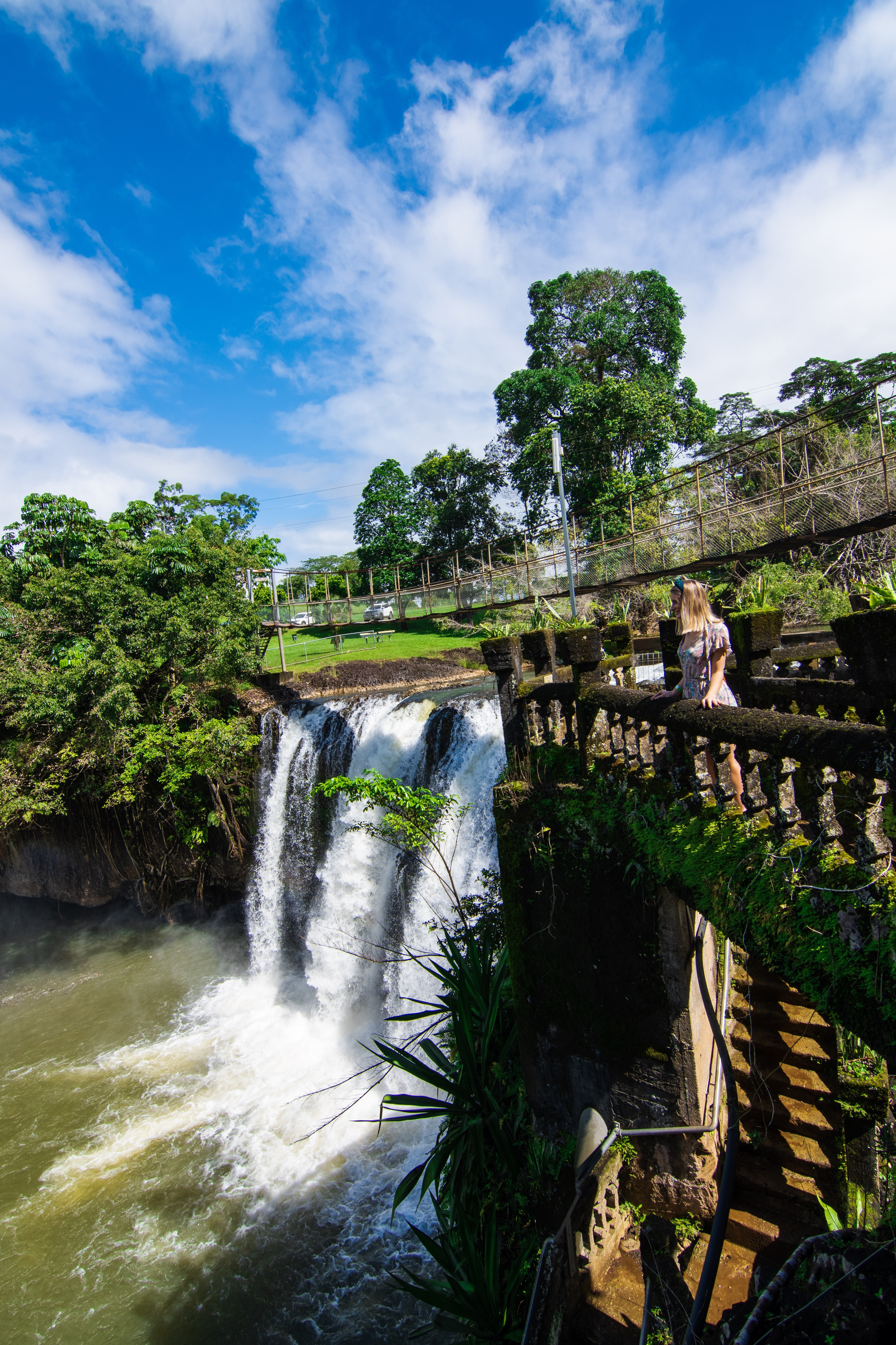 Girl standing next to waterfall at Paronalla Park