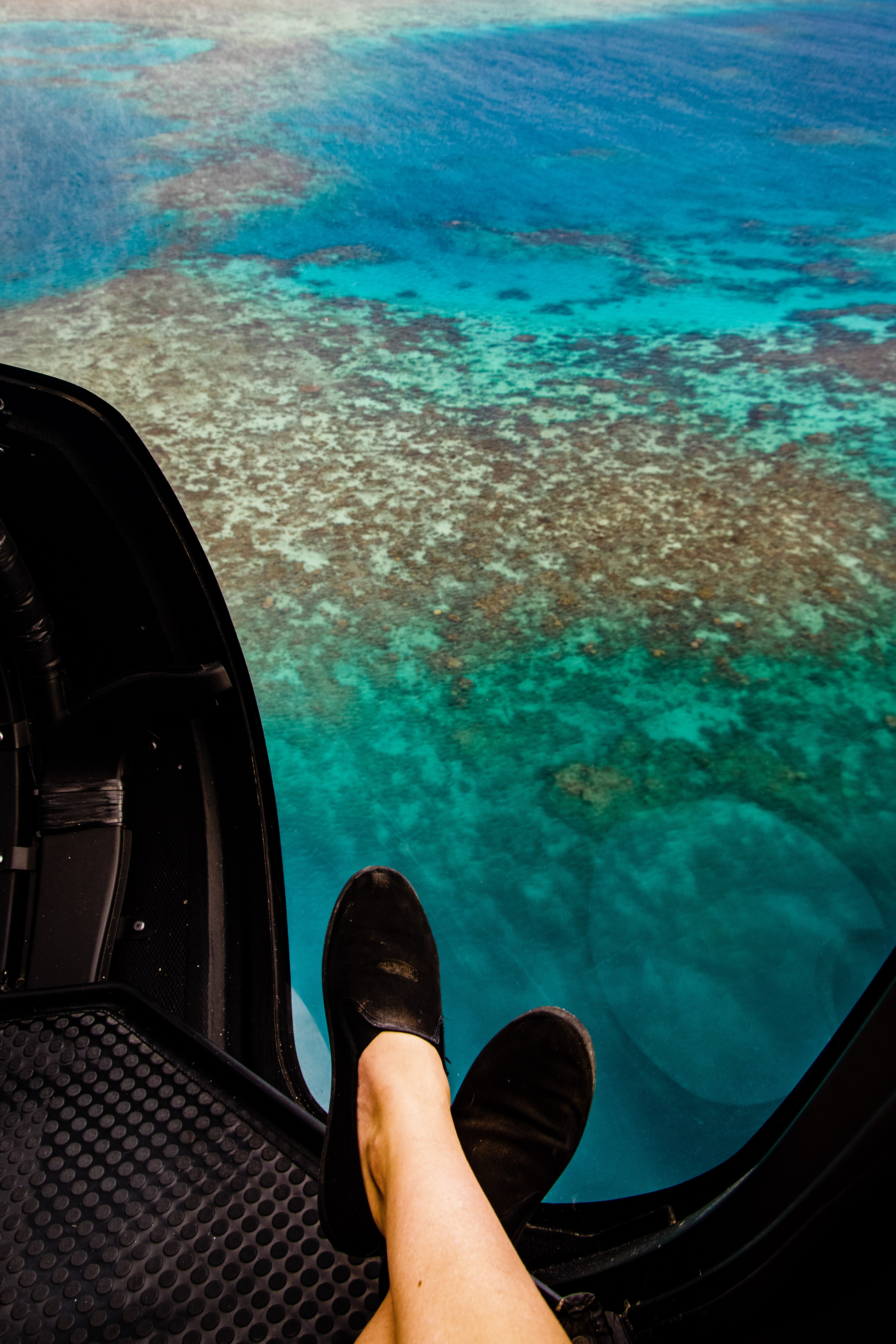 Great Barrier Reef from above from the helicopter with feet in it