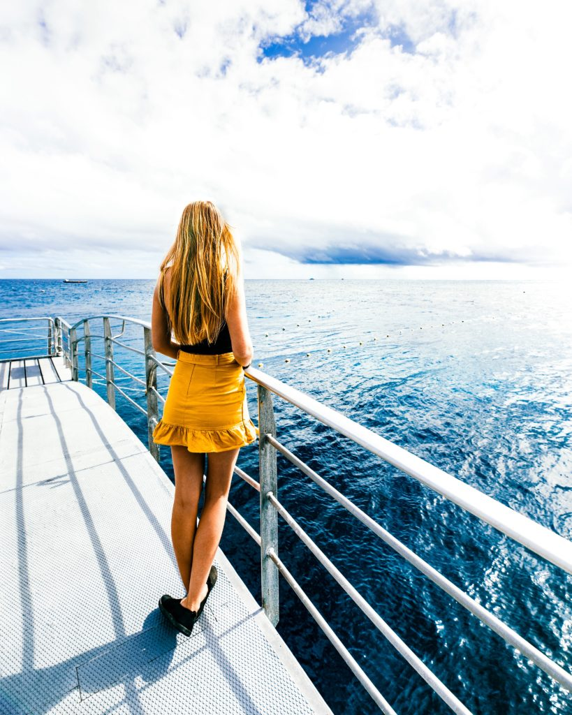 Sarah Latham standing on Quicksilver pontoon in Great Barrier Reef