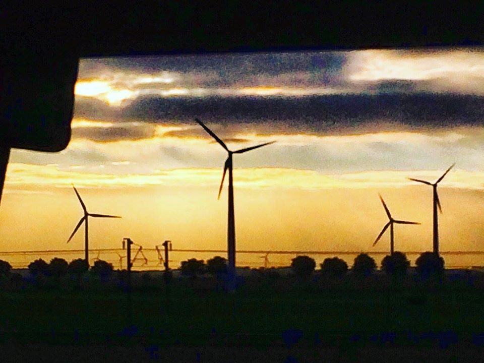 Europe on a budget - sunset from bus between Amsterdam and Paris