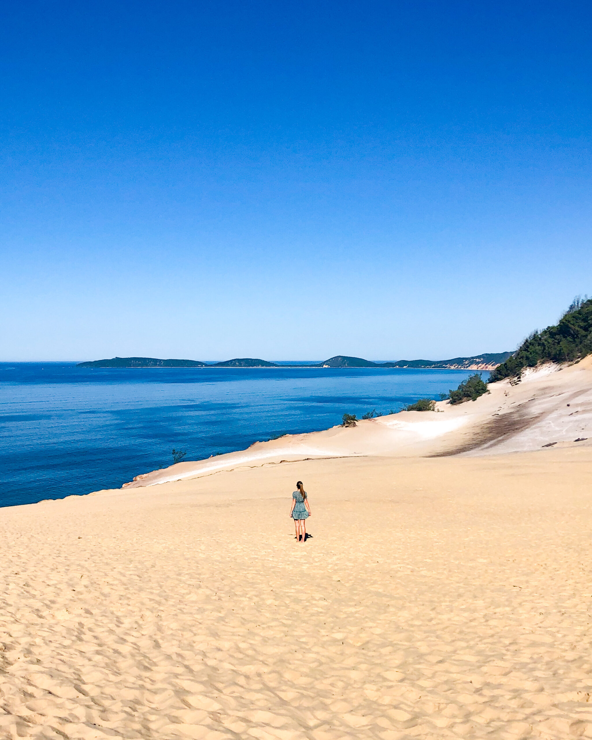 girl standing on sand dune at Carlo Sand Blow